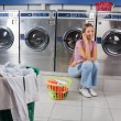 Beautiful Woman Using Mobile Phone At Laundry — Stock Photo