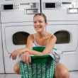 Stock Photo: Beautiful WomWith Clothes Basket
