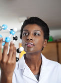 Teacher Looking At Molecular Structure In Science Lab — Stock Photo