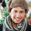 Stock Photo: Handsome Young MAt Christmas Store