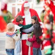 Children Embracing Santa Claus — Stock Photo #32073073
