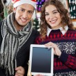 Happy Couple Showing Digital Tablet At Christmas Store — Stock Photo