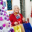 Beautiful Woman With Shopping Bags At Store — Stock Photo