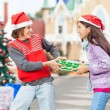 Friends Pulling Christmas Gift — Stock Photo