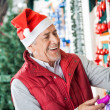 Owner In Santa Hat Working At Christmas Store — Stock Photo