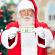 Santa Claus Showing One Dollar Note — Stockfoto