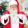 Santa Claus Showing One Dollar Note — Stock fotografie