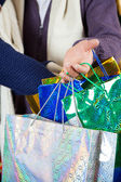 Shopaholic Couple Carrying Shopping Bags At Store — Stock Photo