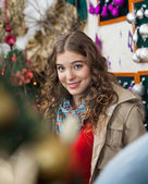 Beautiful Woman In Christmas Store — Stock Photo