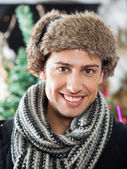Handsome Young Man At Christmas Store — Stock Photo