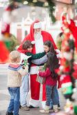 Children Embracing Santa Claus — Stock Photo