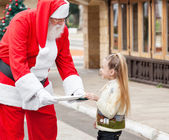 Santa Claus Offering Cookies To Girl — Stock Photo