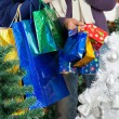 Shopaholic Couple Carrying Shopping Bags At Christmas Store — Stock Photo