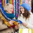 Mother And Daughter Shopping For Tinsels — Foto de Stock