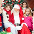 Happy Santa Claus And Children — Stock Photo #32279973