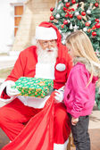 Santa Claus Giving Present To Girl — Photo