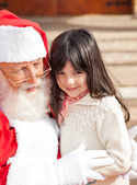 Cute Girl With Santa Claus — Stock Photo