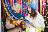 Mother And Daughter Shopping For Tinsels — Stock Photo