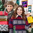 Happy Young Couple In Christmas Store — Stock Photo
