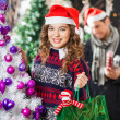 Happy Woman Carrying Shopping Bag In Christmas Store — Stock Photo