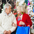 Senior Couple With Shopping Bags At Christmas Store — Stock Photo #32280887