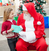 Girl Giving Wish List To Santa Claus — Photo