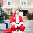 Stock Photo: SantClaus Sitting In Courtyard