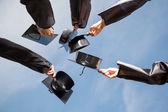 Students Raising Mortar Boards Against Sky On Graduation Day — Stock Photo