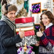 Couple Gesturing Thumbs Up While Holding Christmas Presents — Stock Photo