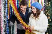 Couple Shopping For Tinsels At Store — Stock Photo