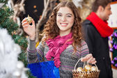 Beautiful Woman Shopping Ornaments At Christmas Store — Stock Photo