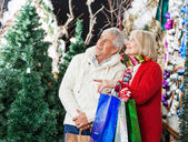Couple Shopping At Christmas Store — Stock Photo