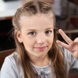 Schoolgirl Gesturing Victory Sign In Computer Lab — Stock Photo