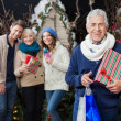 Happy Family With Christmas Presents And Shopping Bags At Store — Stock Photo #33012733