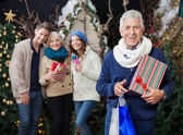 Happy Family With Christmas Presents And Shopping Bags At Store — Stock Photo