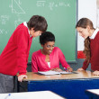 Stock Photo: Teacher Teaching Mathematics To Students