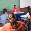 Teacher And Teenage Students Sitting In Classroom — Stock Photo