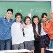 Joyful Schoolchildren Standing Together In Classroom — Stock Photo