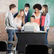 Students And Teacher Discussing Over Laptop In Classroom — Stock Photo