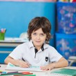 Boy With Sketch Pen Drawing In Classroom — Stock Photo