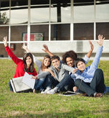 College Students With Hands Raised Sitting At Campus — Stock Photo