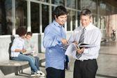 Professor With Books Explaining Student On Campus — Stock Photo