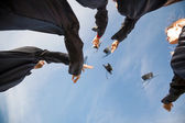 Students Throwing Mortar Boards In Air On Graduation Day — Stock Photo