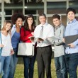 Happy Students With Teacher Standing On College Campus — Stock Photo #33057195