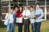 Happy Students With Teacher Standing On College Campus — Stock Photo