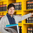 Student Choosing Book From Shelf In Library — Stock Photo