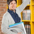 Male Student Choosing Books In College Library — Stock Photo