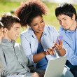 Student Using Mobilephone While Classmates Looking At It — Foto Stock