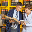 Librarian Assisting Student In University Library — Stock Photo
