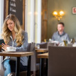 Pregnant Woman Using Digital Tablet At Table — Stock Photo
